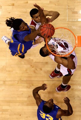 DAYTON, OH - MARCH 20: Kenneth Faried #35 of the Morehead State Eagles drives to the hoop against Jared Swopshire #21 and Samardo Samuels #24 of the Louisville Cardinals during the first round of the NCAA Division I Men's Basketball Tournament at the Univ