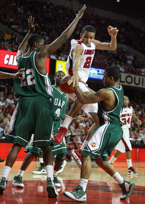 LOUISVILLE, KY - DECEMBER 27: Jared Swopshire #21 of the Louisville Cardinals looses control of the ball while defended by Cameron Moore #22 and Aaron Johnson #1 of the UAB Blazers during the game on December 27, 2008 at Freedom Hall in Louisville, Kentuc