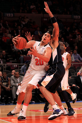 NEW YORK - NOVEMBER 18:  Jordan Williams #20 of the Maryland Terrapin drives past Gary McGhee #52 of the Pittsburgh Panthers during the 2k Sports Classic at Madison Square Garden on November 18, 2010 in New York, New York.  (Photo by Chris McGrath/Getty I