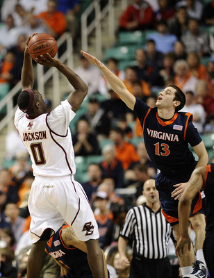 GREENSBORO, NC - MARCH 11:  Sammy Zeglinski #13 of the University of Virginia Cavaliers guards Reggie Jackson #0 of the Boston College Eagles in their first round game in the 2010 ACC Men's Basketball Tournament at the Greensboro Coliseum on March 11, 201