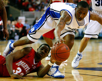ATLANTA - MARCH 14:  Nolan Smith #2 of the Duke Blue Devils grabs a loose ball against Dino Gregory #33 of the Maryland Terrapins during the semifinals of the 2009 ACC Men's Basketball Tournament on March 14, 2009 at the Georgia Dome in Atlanta, Georgia.