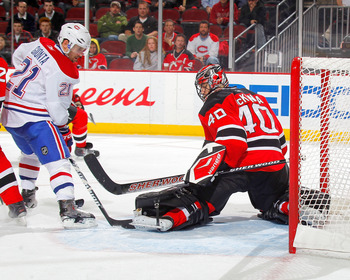NEWARK, NJ - DECEMBER 02:  Brian Gionta #21 of the Montreal Canadiens is stopped by goalie Mike McKenna #40 of the New Jersey Devils during the third period of a hockey game at the Prudential Center on December 2, 2010 in Newark, New Jersey.  (Photo by Pa