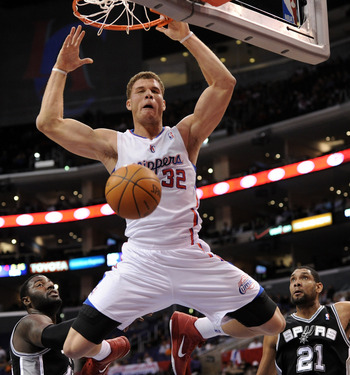 LOS ANGELES, CA - DECEMBER 01:  Blake Griffin #32 of the Los Angeles Clippers reacts to his dunk in front of DeJuan Blair #45 and Tim Duncan #21 of the San Antonio Spurs at the Staples Center on December 1, 2010 in Los Angeles, California.  NOTE TO USER: