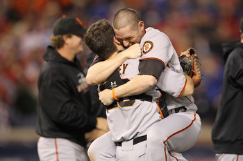 ARLINGTON, TX - NOVEMBER 01:  Buster Posey #28 hugs Aubrey Huff #17 (R) of the San Francisco Giants celebrate their 3-1 victory to win the World Series over the Texas Rangers in Game Five of the 2010 MLB World Series at Rangers Ballpark in Arlington on No