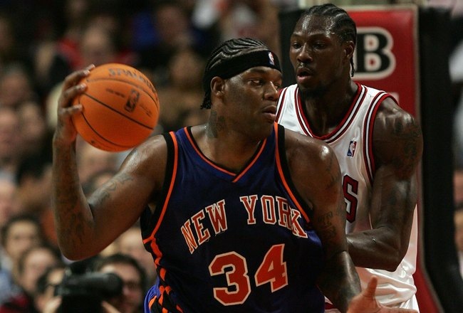 CHICAGO - NOVEMBER 28:  Eddy Curry #34 of the New York Knicks looks to move the ball in the post against Ben Wallace #3 of the Chicago Bulls November 28, 2006 at the United Center in Chicago, Illinois. The Bulls won 102-85. NOTE TO USER: User expressly ac