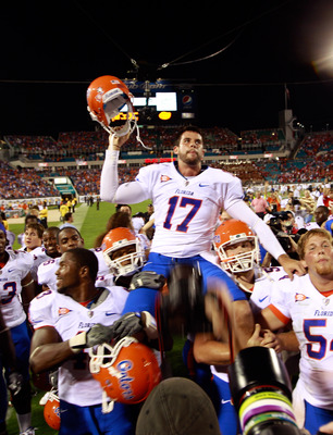 JACKSONVILLE, FL - OCTOBER 30:  Chas Henry #17 of the Florida Gators raises his helmet in vicrtory following the game against the Georgia Bulldogs at EverBank Field on October 30, 2010 in Jacksonville, Florida.  (Photo by Sam Greenwood/Getty Images)