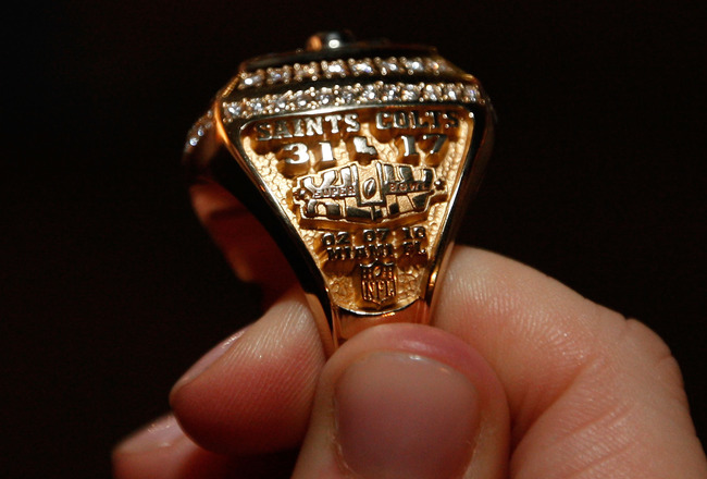 NEW ORLEANS - JUNE 16:  A member of the New Orleans Saints shows off their ring from Super Bowl XLIV on June 16, 2010 in New Orleans, Louisiana.  (Photo by Chris Graythen/Getty Images)