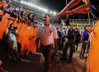 GAINESVILLE, FL - SEPTEMBER 25:  Head coach Urban Meyer of the Florida Gators walks off the field after defeating the Kentucky Wildcats at Ben Hill Griffin Stadium on September 25, 2010 in Gainesville, Florida. Florida defeated Kentucky 48-14 for Meyer's