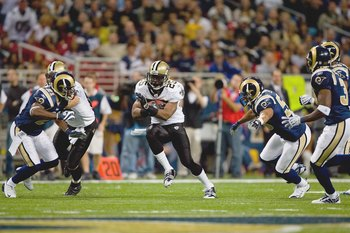 ST. LOUIS - NOVEMBER 15: Reggie Bush #25 of the New Orleans Saints carries the ball during the game against the St. Louis Rams at the Edward Jones Dome on November 15, 2009 in St. Louis, Missouri.  (Photo by Dilip Vishwanat/Getty Images)