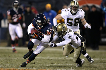 CHICAGO - DECEMBER 11:  Devin Hester #23 of the Chicago Bears runs for yards after the catch against Josh Bullocks #29 of the New Orleans Saints at Soldier Field on December 11, 2008 in Chicago, Illinois. The Bears won 27-24. (Photo by Jonathan Daniel/Get