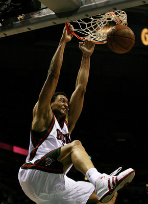 MILWAUKEE - FEBRUARY 09: Dan Gadzuric #50 of the Milwaukee Bucks dunks the ball against the Houston Rockets on February 9, 2009 at the Bradley Center in Milwaukee, Wisconsin. The Bucks defeated the Rockets 124-112. NOTE TO USER: User expressly acknowledge