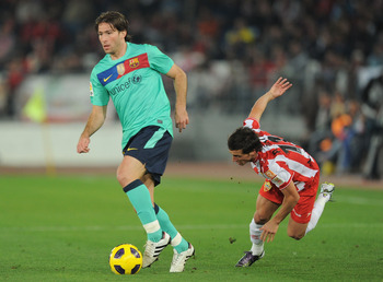 ALMERIA, SPAIN - NOVEMBER 20: Maxwell of Barcelona beats Pablo Daniel Piatti of UD Almeria during the La Liga match between UD Almeria and Barcelona at Estadio del Mediterraneo on November 20, 2010 in Almeria, Spain.  (Photo by Denis Doyle/Getty Images)