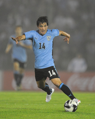 MONTEVIDEO, URUGUAY - NOVEMBER 18:  Nicolas Lodeiro of Uruguay in action during the 2010 FIFA World Cup Play Off Second Leg Match between Uruguay and Costa Rica at The Estadio Centenario on November 18, 2009 in Montevideo, Uruguay.  (Photo by Laurence Gri