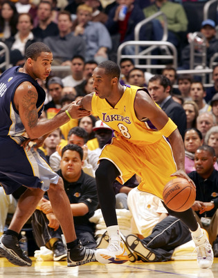 LOS ANGELES - DECEMBER 28:   Kobe Bryant #8 of the Los Angeles Lakers drives to the basket against Dahntay Jones #30 of the Memphis Grizzlies on December 28, 2005 at Staples Center in Los Angeles, California. NOTE TO USER: User expressly acknowledges and