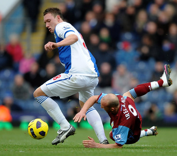 BLACKBURN, ENGLAND - NOVEMBER 21:  Phil Jones of Blackburn Rovers tangles with Stephen Ireland of Aston Villa during the Barclays Premier League match between Blackburn Rovers and Aston Villa at Ewood Park on November 21, 2010 in Blackburn, England.  (Pho