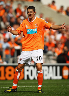 BLACKPOOL, ENGLAND - AUGUST 28:  Craig Cathcart of Blackpool in action during the Barclays Premier League match between Blackpool and Fulham at Bloomfield Road on August 28, 2010 in Blackpool, England.  (Photo by Matthew Lewis/Getty Images)