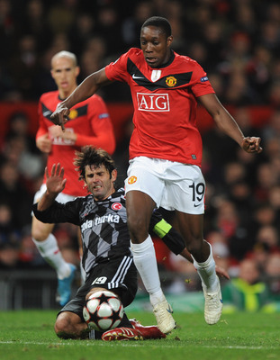 MANCHESTER, ENGLAND - NOVEMBER 25:  Ibrahim Uzulmez of Besiktas tackles Danny Welbeck of Manchester United during the UEFA Champions League Group B match between Manchester United and Besiktas at Old Trafford on November 25, 2009 in Manchester, England.