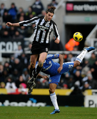 NEWCASTLE UPON TYNE, ENGLAND - NOVEMBER 28:  Andy Carroll of Newcastle United competes with Florent Malouda of Chelsea during the Barclays Premier League match between Newcastle United and Chelsea at St James' Park on November 28, 2010 in Newcastle, Engla