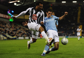 WEST BROMWICH, ENGLAND - SEPTEMBER 22:  Greg Cunningham of Manchester City tackles Giles Barnes of West Bromwich Albion attempts a shot on goal during the Carling Cup 3rd Round match between West Bromwich Albion and Manchester City at The Hawthorns on Sep