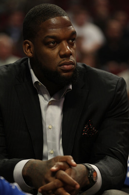 CHICAGO - NOVEMBER 04: Eddy Curry of the New York Knicks sits on the bench and watches his teammates take on the Chicago Bulls at the United Center on November 4, 2010 in Chicago, Illinois. NOTE TO USER: User expressly acknowledges and agrees that, by dow