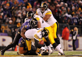 BALTIMORE, MD - DECEMBER 05:  Quarterback Ben Roethlisberger #7 of the Pittsburgh Steelers is sacked by linebacker Terrell Suggs #55 of the Baltimore Ravens during the first half of the game at M&T Bank Stadium on December 5, 2010 in Baltimore, Maryland.