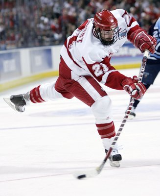 MILWAUKEE - APRIL 06:  Andy Brandt #21 of the Wisconsin Badgers takes a shot against the Maine Black Bears during the NCAA Frozen Four on April 6, 2006 at the Bradley Center in Milwaukee, Wisconsin.  (Photo by Elsa/Getty Images)