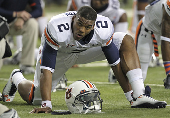 ATLANTA - DECEMBER 04:  Quarterback Cam Newton #2 of the Auburn Tigers stretches before the 2010 SEC Championship against the South Carolina Gamecocks at Georgia Dome on December 4, 2010 in Atlanta, Georgia.  (Photo by Mike Zarrilli/Getty Images)