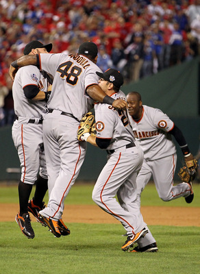ARLINGTON, TX - NOVEMBER 01:  (L-R) Cody Ross #13, Pablo Sandoval #48, Freddy Sanchez #21 and Edgar Renteria #16 of the San Francisco Giants celebrate after they won 3-1 against the Texas Rangers in Game Five of the 2010 MLB World Series at Rangers Ballpa