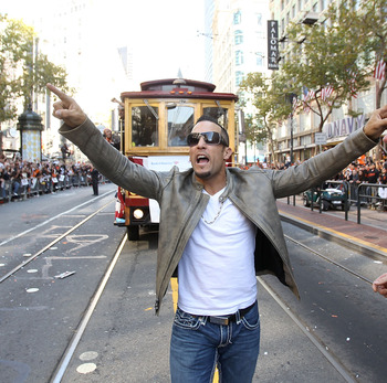 SAN FRANCISCO - NOVEMBER 03:  Andres Torres of the San Francisco Giants walks down the street during the San Francisco Giants victory parade on November 3, 2010 in San Francisco, California.  (Photo by Ezra Shaw/Getty Images)