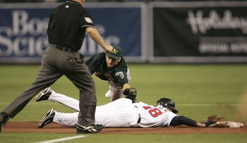 Marco Scutaro tries to lay a tag on Jason Bartlett