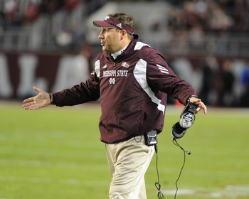 TUSCALOOSA, AL - NOVEMBER 13: Coach Dan Mullen of the Mississippi State Bulldogs directs play against the Alabama Crimson Tide November 13, 2010 at Bryant-Denny Stadium in Tuscaloosa, Alabama.  (Photo by Al Messerschmidt/Getty Images)