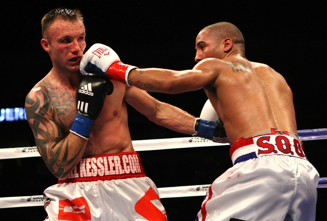 OAKLAND, CA - NOVEMBER 21:  Mikkel Kessler of Denmark (L) is hit by Andre Ward during their WBA Super Middleweight Championship Bout at the Oakland-Alameda County Coliseum on November 21, 2009 in Oakland, California.  (Photo by Jed Jacobsohn/Getty Images)