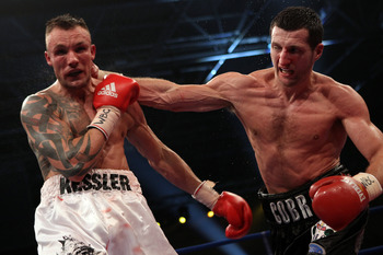 HERNING, DENMARK - APRIL 24:  Carl Froch of England (R) connects with a right against Mikkel Kessler of Denmark during their Super Six WBC Super Middleweight title fight on April 24, 2010 at MCH  Messecenter Arena in Herning, Denmark.  (Photo by John Gich