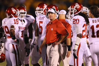 COLUMBIA, MO - OCTOBER 23: Head coach Bob Stoops of the Oklahoma Sooners looks on against the Missouri Tigers at Faurot Field/Memorial Stadium on October 23, 2010 in Columbia, Missouri.  The Tigers beat the Sooners 36-27.  (Photo by Dilip Vishwanat/Getty