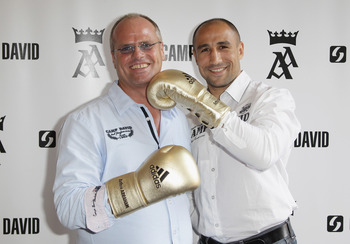 BERLIN - SEPTEMBER 16:  (L-R) Thomas Finkbeiner, CEO of Camp David and boxer Arthur Abraham pose during a press conference on September 16, 2010 in Berlin, Germany. Abraham signed a co-operation with German retail clothes company Camp David.  (Photo by An