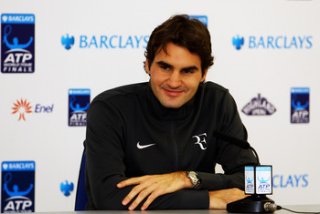 LONDON, ENGLAND - NOVEMBER 28: Roger Federer of Switzerland speaks at a press conference after winning his men's final match against Rafael Nadal of Spain during the ATP World Tour Finals at O2 Arena on November 28, 2010 in London, England.  (Photo by Cli