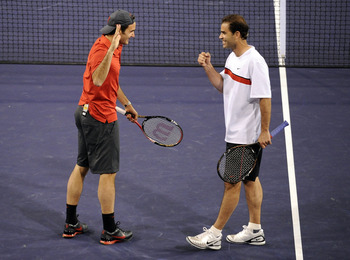 INDIAN WELLS, CA - MARCH 12:  Pete Sampras (R) of the United States and Roger Federer of Switzerland celebrate a point in their match against Andre Agassi of the United States and Rafael Nadal of Spain during the BNP Paribas Open  Players Party & Hit for