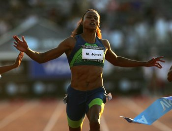INDIANAPOLIS - JUNE 23:  Marion Jones crosses the finish line to win the 100 meter dash final on day two of the AT&amp;T USA Outdoor Track and Field Championships at Indiana University Track and Field Stadium on June 23, 2006 in Indianapolis, Indiana.  (Photo