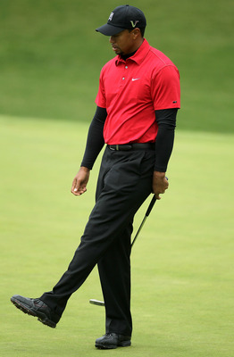 THOUSAND OAKS, CA - DECEMBER 05:  Tiger Woods reacts after missing a birdie putt attempt on the 10th hole during the final round of the Chevron World Challenge at Sherwood Country Club on December 5, 2010 in Thousand Oaks, California.  (Photo by Stephen D