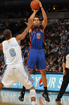 DENVER - NOVEMBER 16:  Landry Fields #6 of the New York Knicks takes a shot over Arron Afflalo #6 of the Denver Nuggets at the Pepsi Center on November 16, 2010 in Denver, Colorado. The Nuggets defeated the Knicks 120-118. NOTE TO USER: User expressly ack