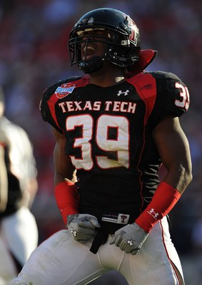 DALLAS - JANUARY 02:  Marlon Williams #39 of the Texas Tech Red Raiders during play against the Mississippi Rebels during the AT&T Cotton Bowl on January 2, 2009 at the Cotton Bowl in Dallas, Texas.  (Photo by Ronald Martinez/Getty Images)