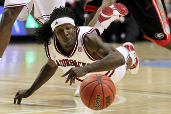 NASHVILLE, TN - MARCH 11:  Courtney Fortson #4 of the Arkanasas Razorbacks dives for a loose ball against the Georgia Bulldogs during the first round of the SEC Men's Basketball Tournament at the Bridgestone Arena on March 11, 2010 in Nashville, Tennessee