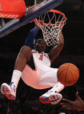 NEW YORK, NY - NOVEMBER 30: Amar'e Stoudemire #1 of the New York Knicks dunks the ball against the New Jersey Nets on November 30, 2010 at Madison Square Garden in New York City. NOTE TO USER: User expressly acknowledges and agrees that, by downloading an
