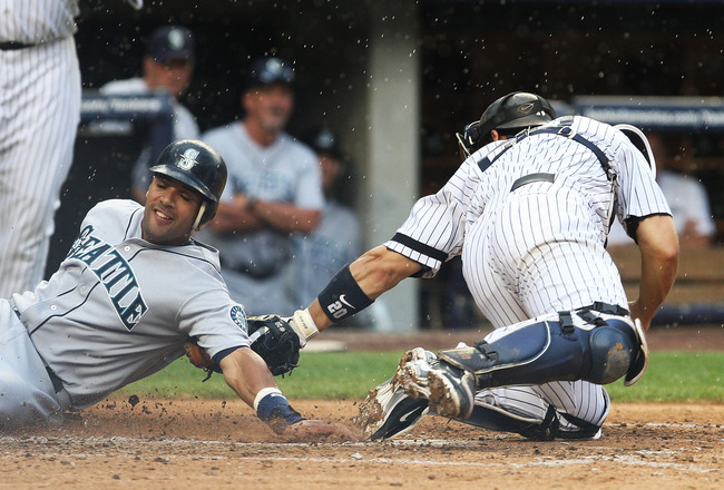 NEW YORK - AUGUST 22:  Franklin Gutierrez #21 of the Seattle Mariners is tagged out at home by Jorge Posada #20 of the New York Yankees in the fifth inning on August 22, 2010 at Yankee Stadium in the Bronx borough of New York City.  (Photo by Andrew Burto