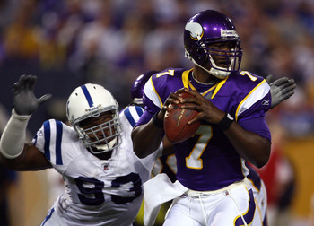 MINNEAPOLIS - SEPTEMBER 14:  Quarterback Tavaris Jackson #7 of the Minnesota Vikings drops back to pass before being sacked by Dwight Freeney #93 of the Indianapolis Colts in the third quarter at the Metrodome on September 14, 2008 in Minneapolis, Minneso