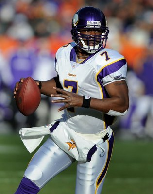 DENVER - DECEMBER 30:  Tavaris Jackson #7 of the Minnesota Vikings looks for an open receiver as he rolls out during the football game against the Denver Broncos at Invesco Field at Mile High on December 30, 2007 in Denver, Colorado.  (Photo by Steve Dyke