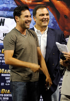 LAS VEGAS - JULY 30:  Golden Boy Promotions President Oscar De La Hoya (L) and CEO of Golden Boy Promotions Richard Schaefer appear during the official weigh-in for WBA/WBO lightweight champion Juan Manuel Marquez and Juan Diaz at the Mandalay Bay Events