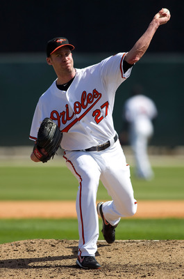 SARASOTA, FL - MARCH 07:  Pitcher Mark Hendrickson #27 of the Baltimore Orioles pitches against the Boston Red Sox during a Grapefruit League Spring Training Game at Ed Smith Stadium on March 7, 2010 in Sarasota, Florida.  (Photo by J. Meric/Getty Images)