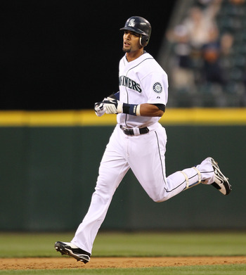 SEATTLE - AUGUST 03:  Franklin Gutierrez #21 of the Seattle Mariners rounds the bases after hitting a home run against the Texas Rangers at Safeco Field on August 3, 2010 in Seattle, Washington. (Photo by Otto Greule Jr/Getty Images)