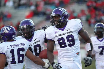 ALBUQUERQUE, NM - NOVEMBER 27: Braylon Broughton #99, Stansly Maponga #90 (C) and Jurell Thompson #16 of the TCU Horned Frogs celebrate after a touchdown against the University of New Mexico Lobos on November 27, 2010 at University Stadium in Albuquerque,